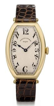 patek_philippe_an_oversized_and_very_rare_18k_gold_tonneau-shaped_hing_d5367859h.jpg